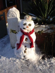 Frosty's in good shape despite a stony stare. Love the hat!