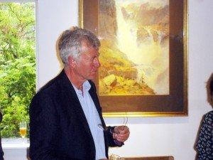 Julian Cooper: behind him, W. Heaton Cooper's watercolour of the Hardanger Falls